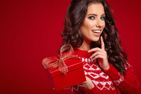 christmas gift: a beauty young girl with christmas gift Stock Photo