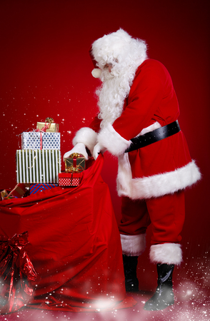 s eve: Santa claus carrying presents in his sack