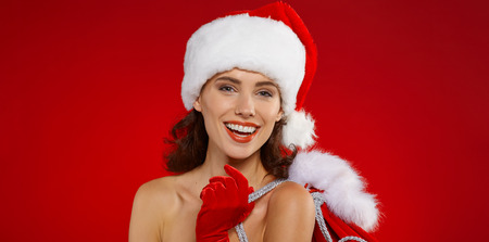 white hat: Cute and sexy female santa claus Stock Photo