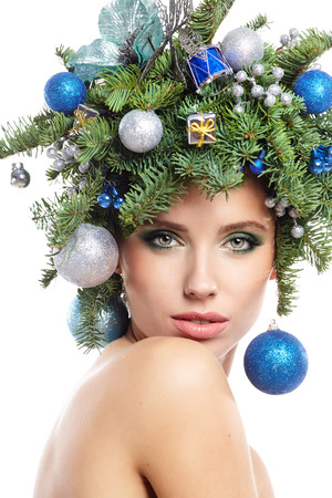 christmas woman: Christmas fashion model woman with Xmas New Year hairstyle and make up.