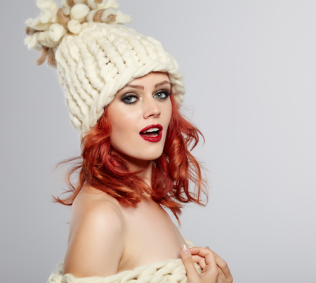 winter fashion: Portrait of a beautiful red hair woman Stock Photo