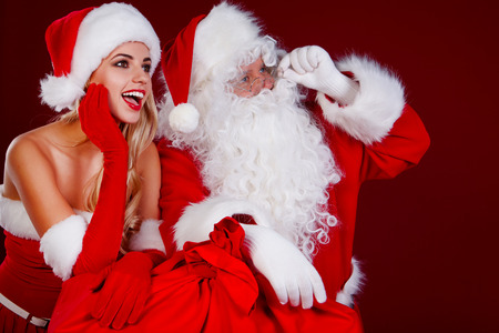 wishlist: Portrait of happy Santa Claus with his woman helper
