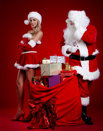 Santa Claus with a woman Christmas helper Stock Photo