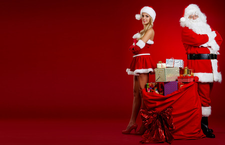 santa helper: Santa Claus with a woman Christmas helper Stock Photo