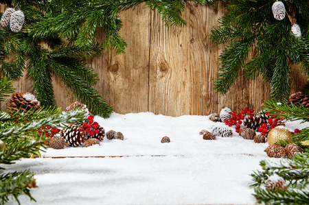 wonder: Christmas fir tree with snow on wooden background Stock Photo