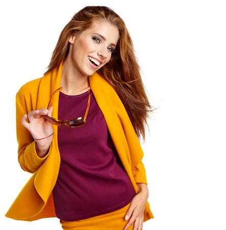 autumn color: young brunette woman portrait in autumn color