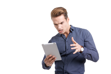 frantic: frustrated young man with tablet