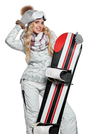 white winter: a beautiful woman with a snowboard in studio Stock Photo