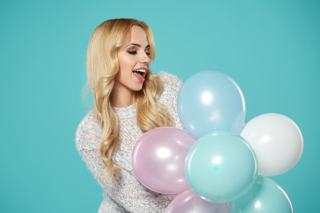 latex woman: Happy young woman with colorful latex balloons