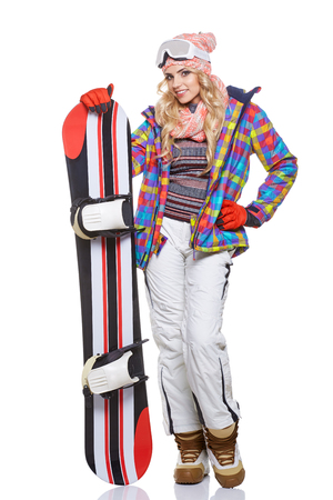 sports clothing: a beautiful woman with a snowboard in studio Stock Photo