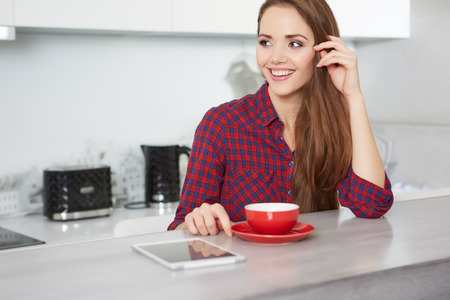 slim girl: young woman drinking coffee at home in the morning Stock Photo