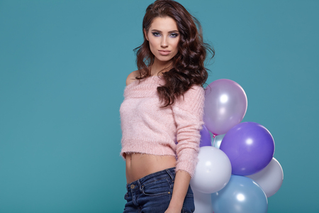 cute teen: woman with  pastel balloon on a blue background