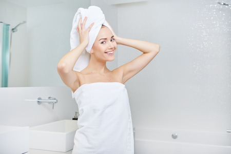 shower cubicle: Fresh Young Woman Wrapped with Towels After Bath, Smiling at the Camera Stock Photo