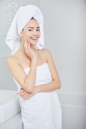 women bathing: Fresh Young Woman Wrapped with Towels After Bath, Smiling at the Camera Stock Photo