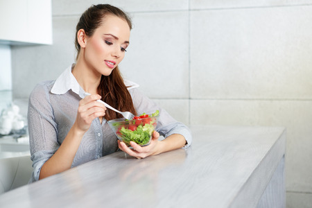 salad bowl: Beautiful Young Woman Eating Vegetable Salad .Dieting concept.Healthy Food Stock Photo