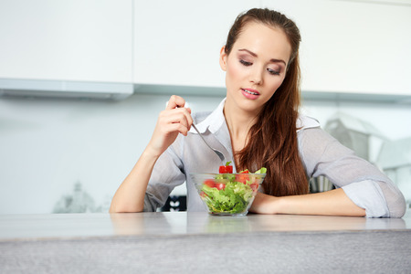 eating salad: Beautiful Young Woman Eating Vegetable Salad .Dieting concept.Healthy Food Stock Photo