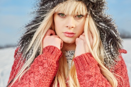winter fashion: Beautiful blond hair girl . winter clothes Stock Photo
