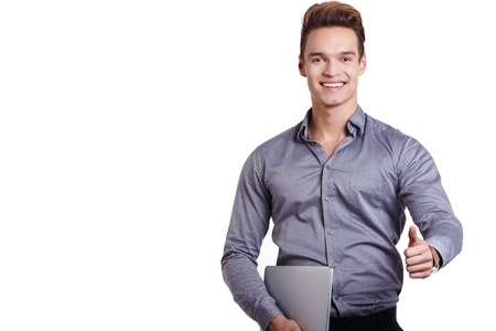 notebook computer: elegant man showing ok sign with a laptop in his hand, isolated