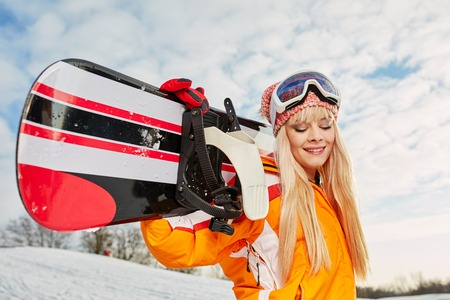 snowboarder: blonde snowboarder on snow. outdoor