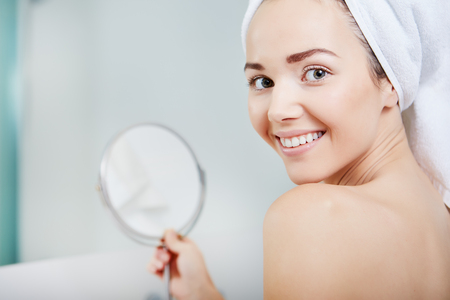face of young beautiful healthy woman and reflection in the mirror Stock Photo