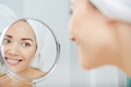 face of young beautiful healthy woman and reflection in the mirror Stock Photo - 51686401