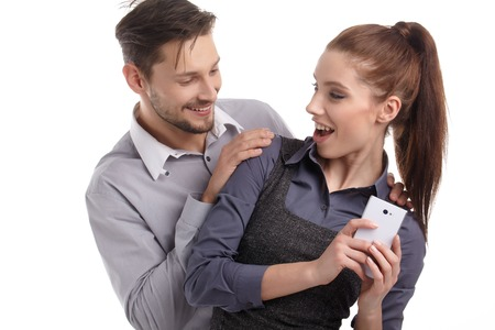 attitudes: couple and secret message on cell phone. the concept of business