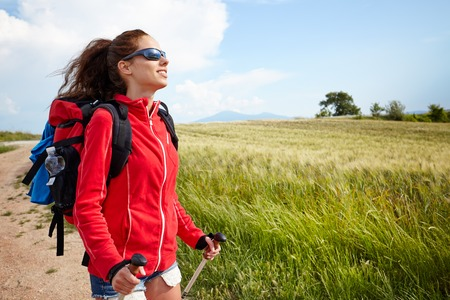 toscana: Female hiking woman happy and smiling during hike trek on Toscana hills Stock Photo