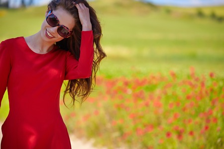 flower fields: young beautiful woman on cereal field in summer Stock Photo