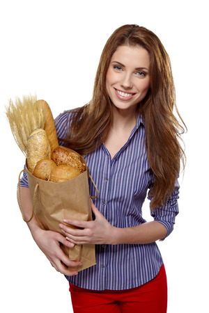 woman bag: Young woman with a grocery shopping bag. Isolated on white background.  Stock Photo