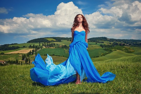nude sexy woman: Portrait of a beauty woman in blue dress on Italy hills