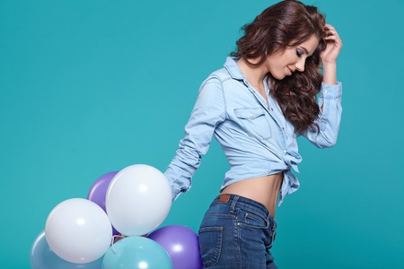 Beautiful woman with colored balloons Archivio Fotografico