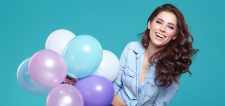 Beautiful woman with colored balloons 스톡 콘텐츠