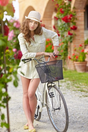 agriturismo: Woman in Tuscany garden. Summer in Italy