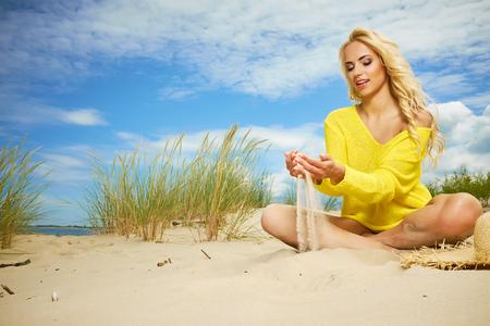 Sexy blonde girl on the summer beach