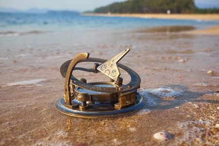 sundial: panorama of tropical beach with old vintage sundial