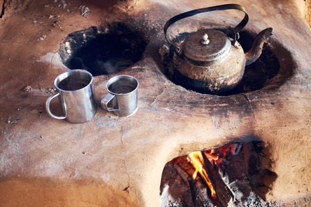 Traditional preparation of tea on clay oven Nepal