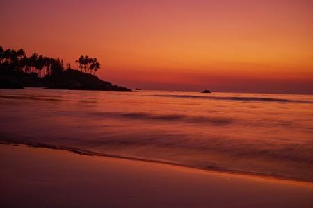 romance sky: Calm peaceful ocean and beach on tropical sunrise. Bali, Indonesia Stock Photo