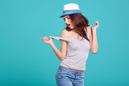 expressive: Young Woman with spring hat against blue background