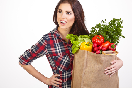 woman bag: Young woman with a grocery shopping bag. Isolated on white background.