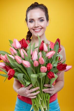 woman portrait: Young beautiful woman studio portrait with tulip flowers Stock Photo