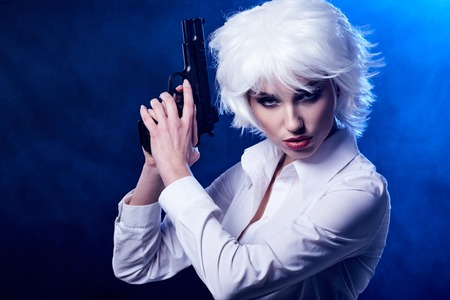 gangster with gun: Beautiful woman with a gun