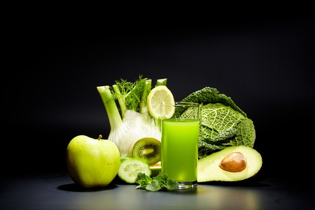 refreshment: healthy vegetable juices for refreshment and as an antioxidant . Black background Stock Photo