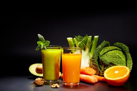 green and black: healthy vegetable juices for refreshment and as an antioxidant . Black background Stock Photo