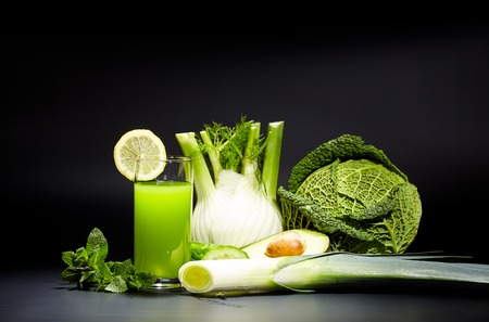 healthy vegetable juices for refreshment and as an antioxidant . Black background Stock Photo