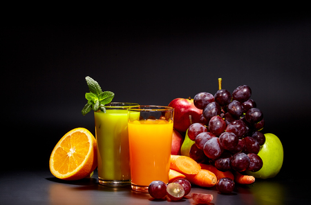 fruits juice: healthy vegetable juices for refreshment and as an antioxidant . Black background Stock Photo