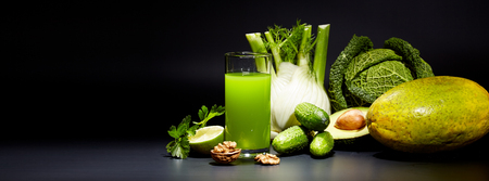 fruit background: healthy vegetable juices for refreshment and as an antioxidant . Black background Stock Photo