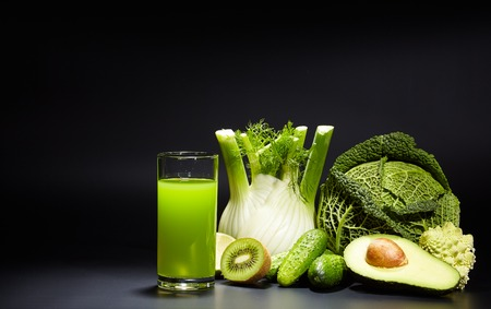 natural juices: healthy vegetable juices for refreshment and as an antioxidant . Black background Stock Photo