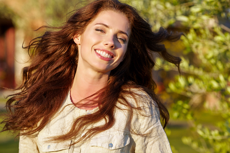 flower garden: Happy woman in summer field. Young girl relax outdoors. Freedom concept