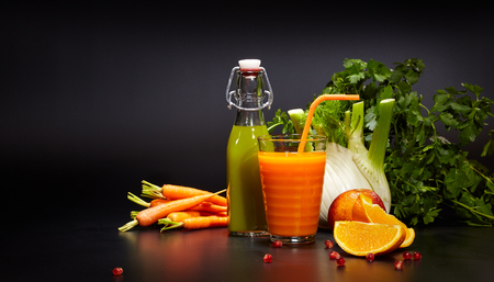 cleanse: Glasses with fresh organic vegetable and fruit juices isolated on black. Detox diet. Stock Photo