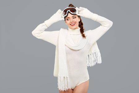 sports clothing: woman in sports thermal body for skiing training ski googles studio shot